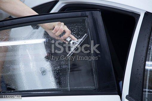 1145626150 istock photo Install windows film on the car. 1172275623