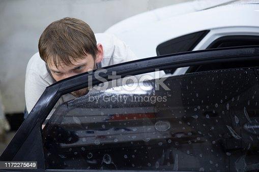 1145626150 istock photo Install windows film on the car. 1172275649