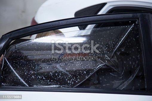 1145626150 istock photo Install windows film on the car. 1172275684
