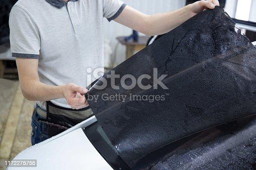 1145626150 istock photo Install windows film on the car. 1172275755