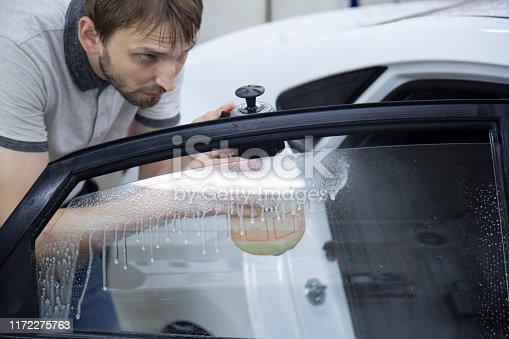 1145626150 istock photo Install windows film on the car. 1172275763
