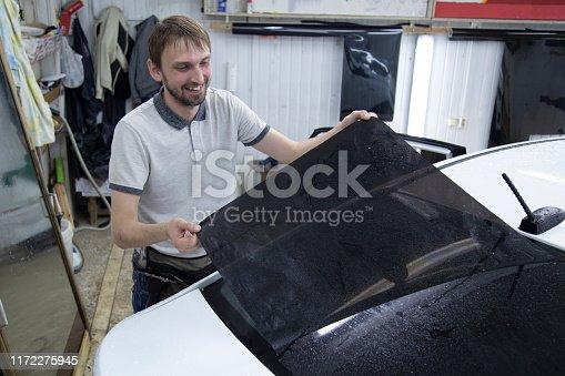 1145626150 istock photo Install windows film on the car. 1172275945