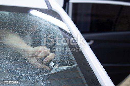 1145626150 istock photo Install windows film on the car. 1172275998