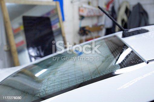 1145626150 istock photo Install windows film on the car. 1172276030