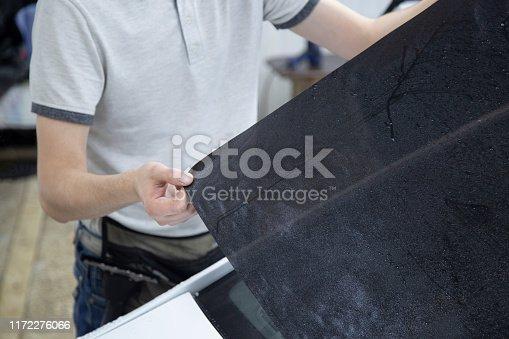 1145626150 istock photo Install windows film on the car. 1172276066
