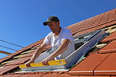 istock Installation and assembly of new roof windows as part of a roof covering 1227005694