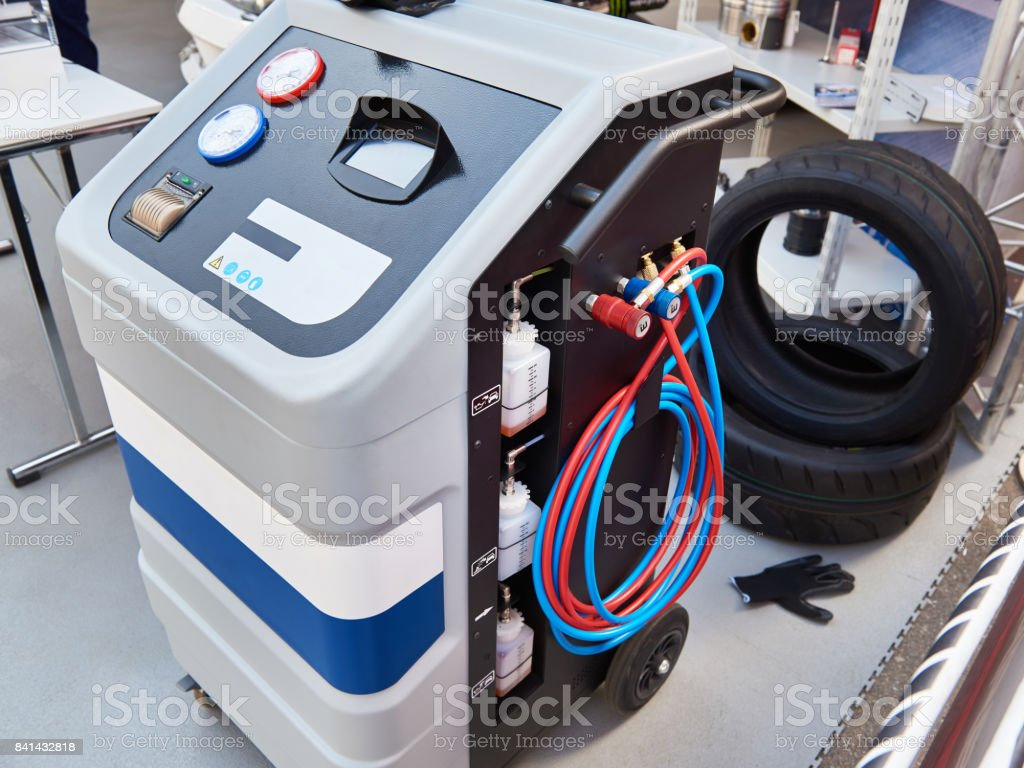 Installation for working with refrigerant in car workshop stock photo