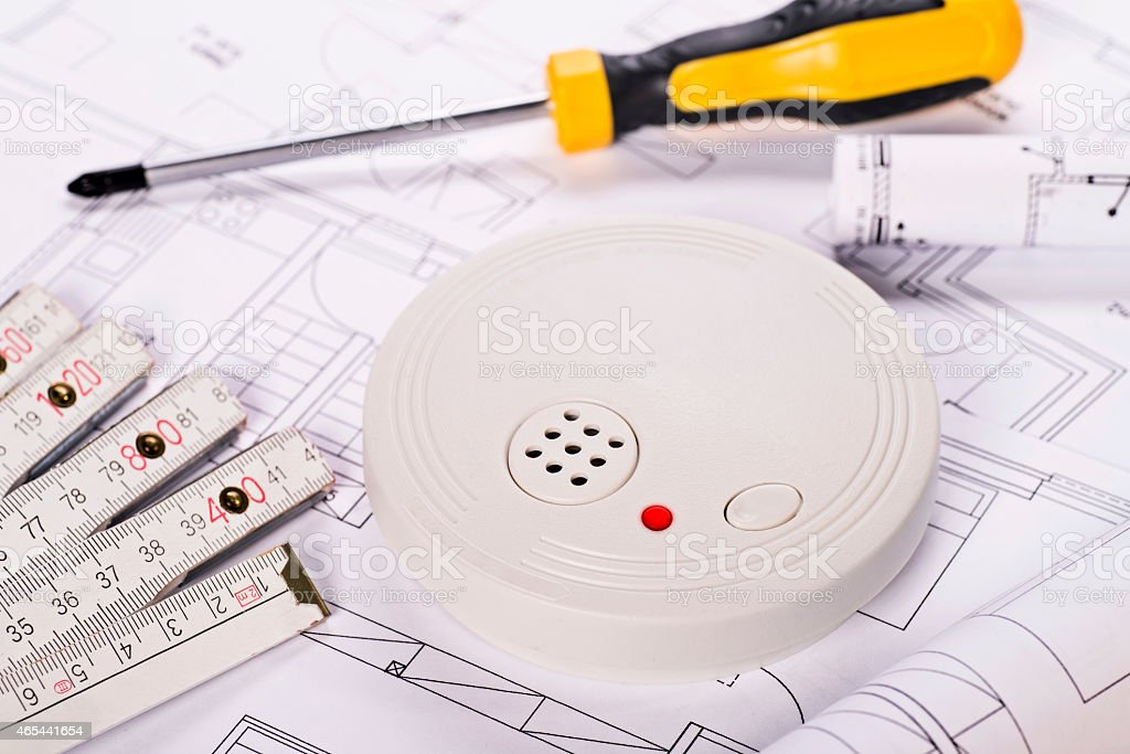 Installation of a smoke detector stock photo