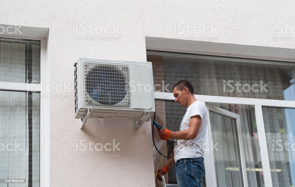 Installation of air conditioner stock photo