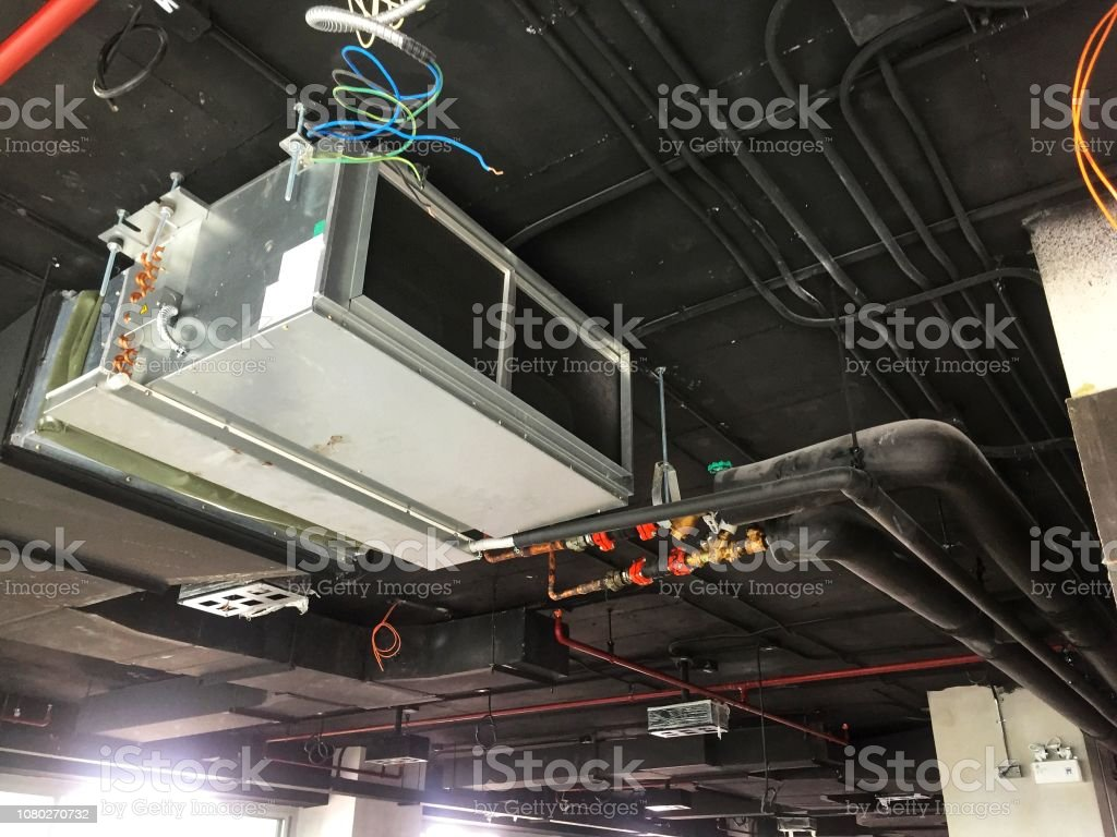 Installation of Air handing unit or Fan coil unit in loft office stock photo