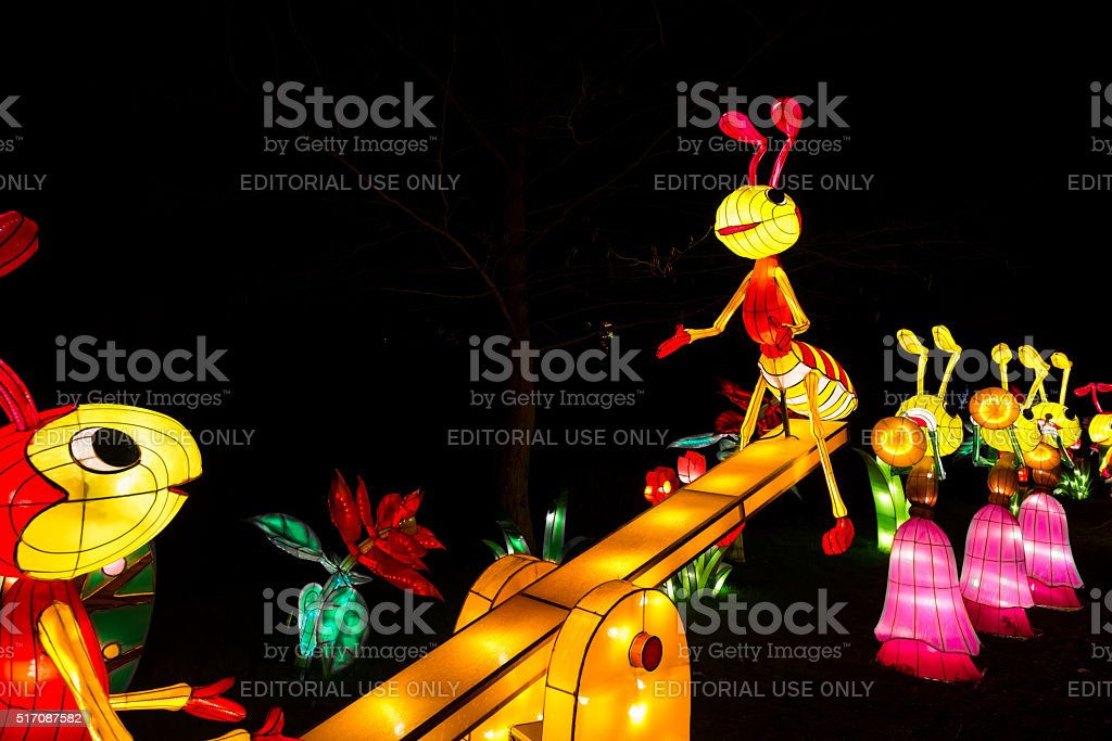 Installation of ants playing at a teetering board stock photo
