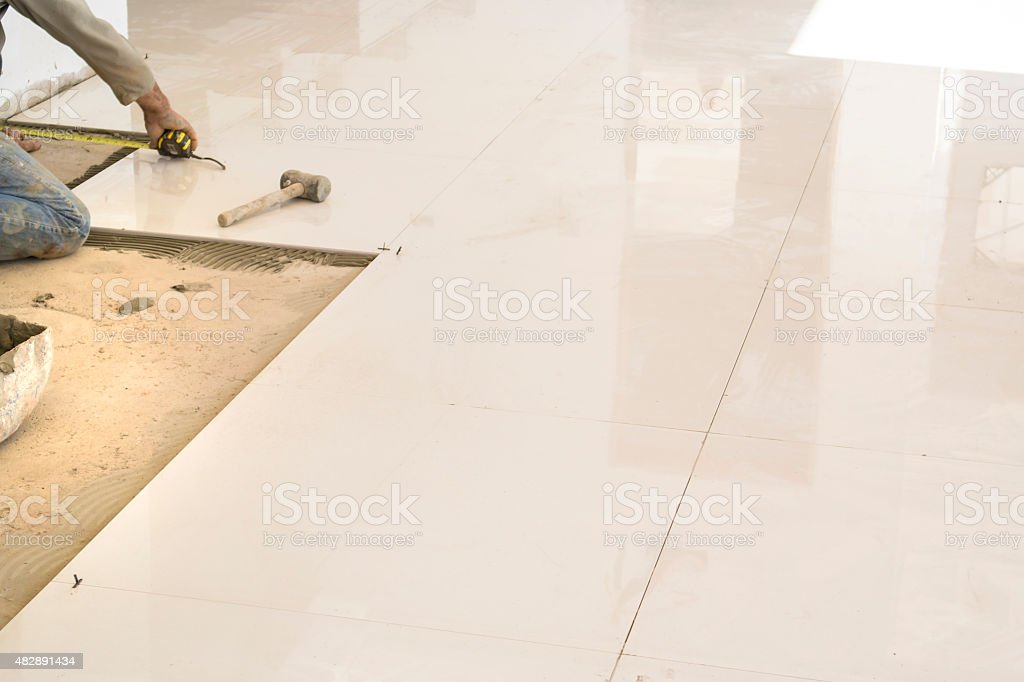 Installation of ceramic tile in residential hallway stock photo