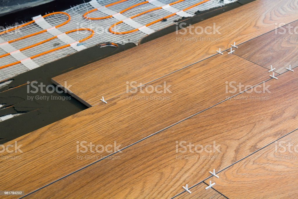Installation Of Ceramic Tiles And Heating Elements In Warm Tile