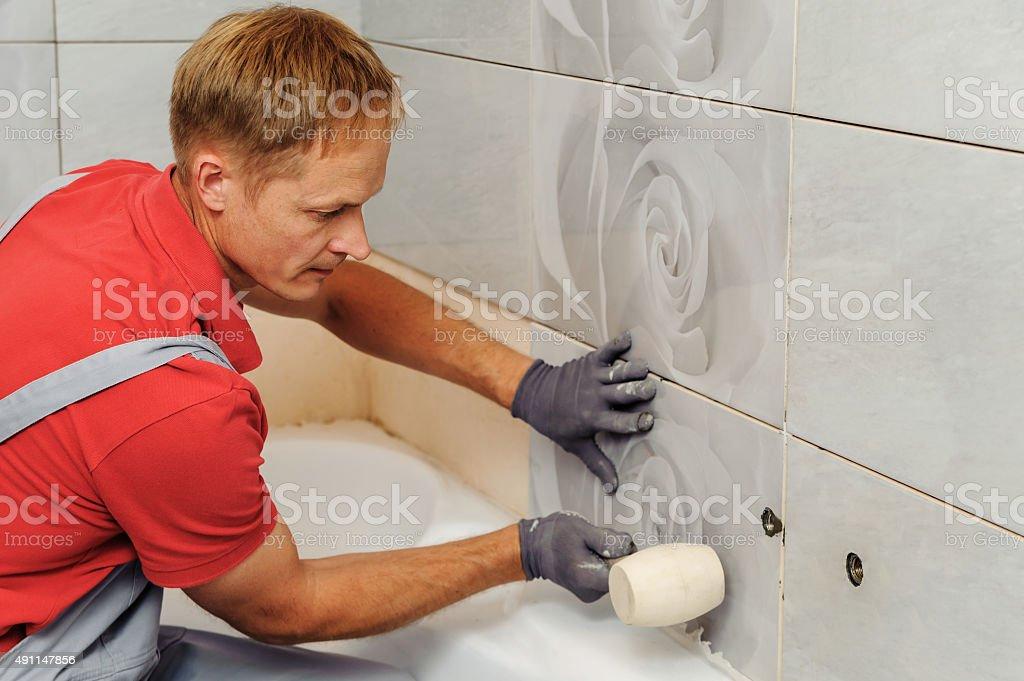 Installation of  ceramic tiles. stock photo