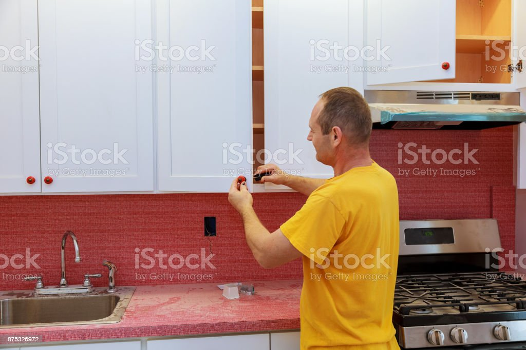 Installation Of Doors On Kitchen Cabinets Stock Photo Download Image Now Istock