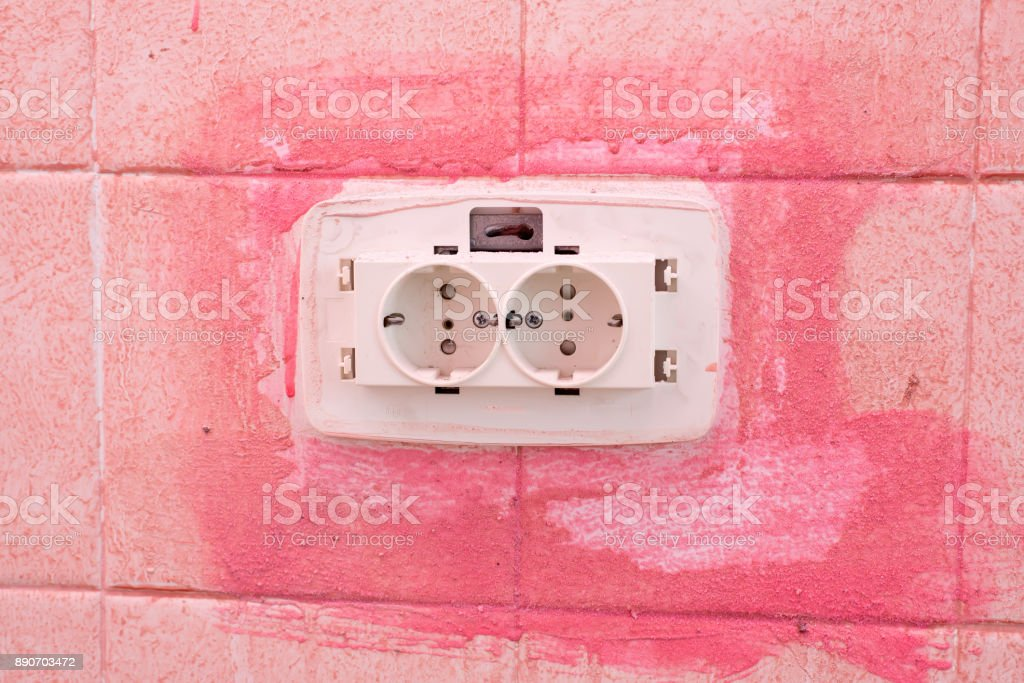 Installation of electrical contacts on the wall. stock photo