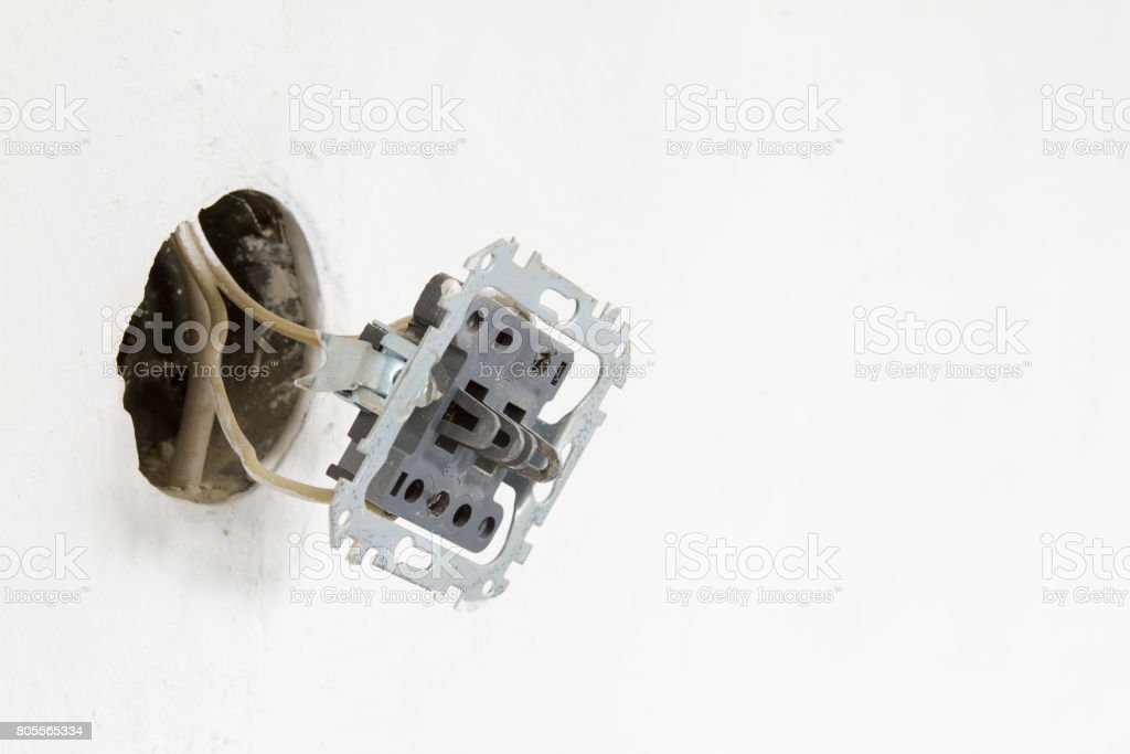 Installation of electrical contacts on the white wall stock photo