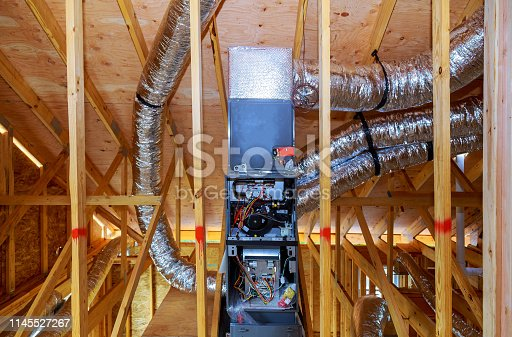 Installation of heating system home construction with roof of the pipe system of heating close up