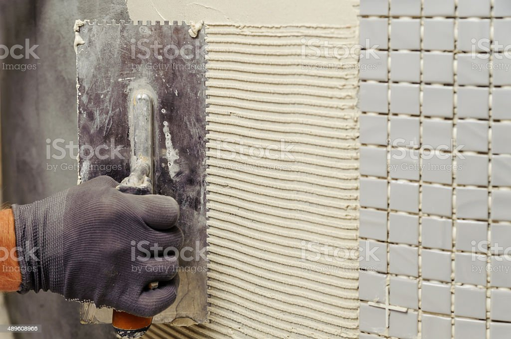 Installation of mosaic tiles. stock photo