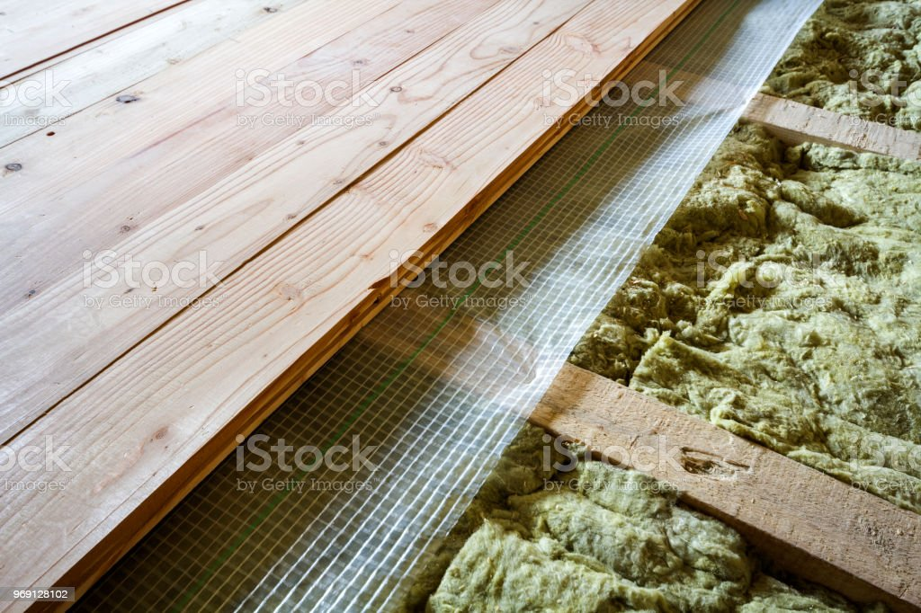 Installation Of New Floor Of Wooden Natural Planks And Mineral Wool