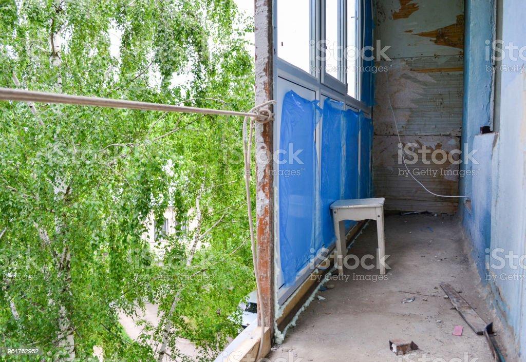 Installation of new windows on the balcony royalty-free stock photo