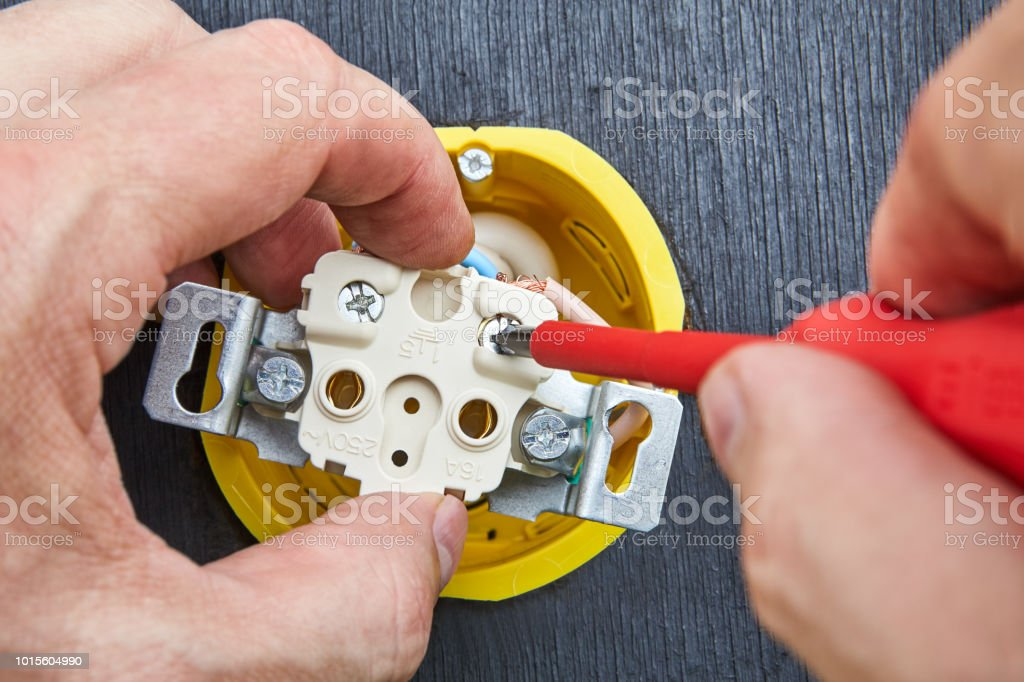 Installation Of Outlet In Household Electrical Wiring Using Crosshead Screwdriver Stock Photo Download Image Now Istock