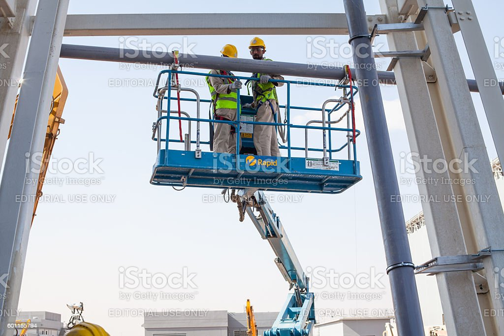 Installation of Pipes using an access platform stock photo