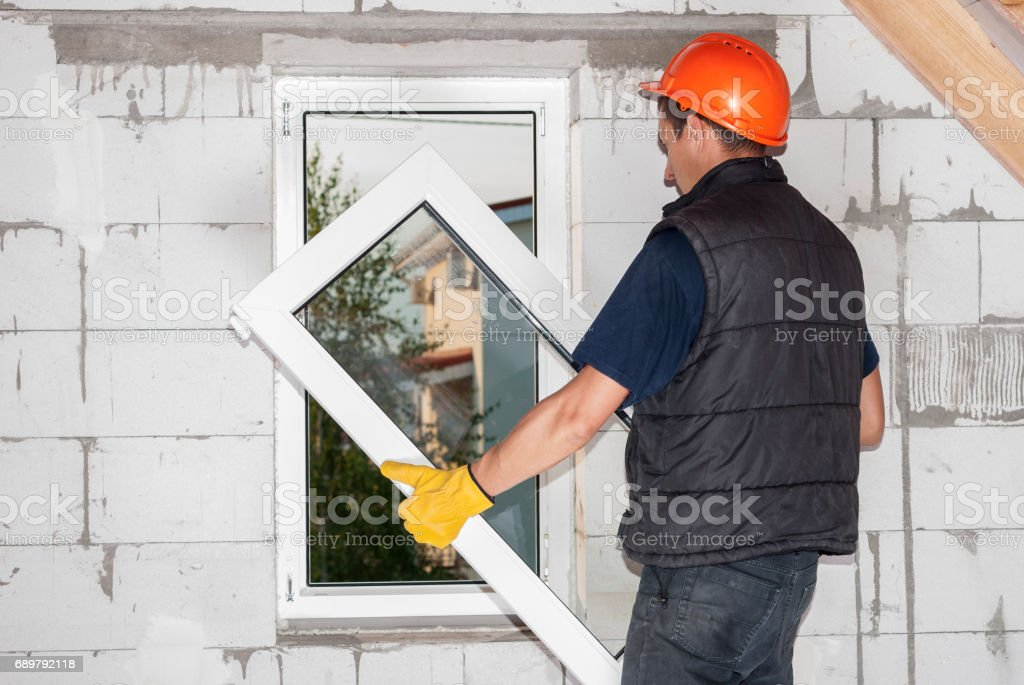 installation of plastic window stock photo
