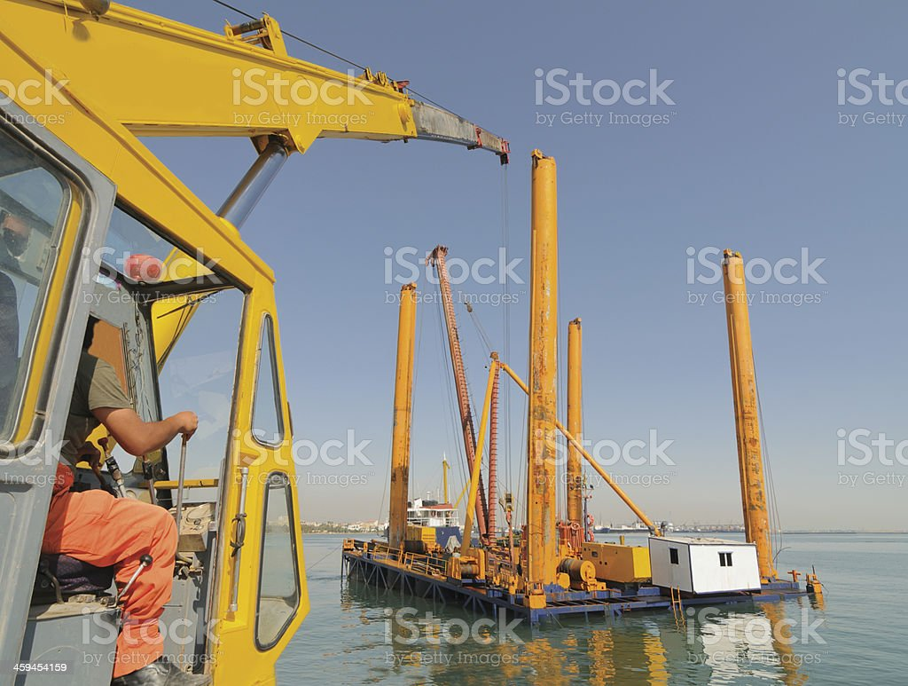 installation of platforms on the sea stock photo
