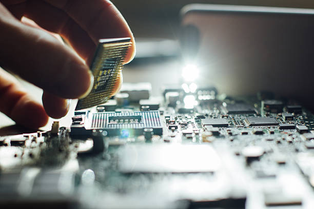 Installation of processor in CPU socket stock photo
