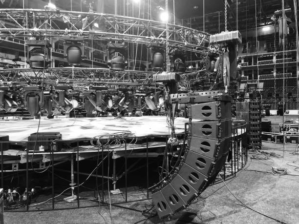 Installation of professional concert equipment. Lifting of line array speakers. Truss with spot lighting equipment above the stage. Installation of professional concert equipment. Lifting of line array speakers. Truss with spot lighting equipment above the stage. rigging stock pictures, royalty-free photos & images