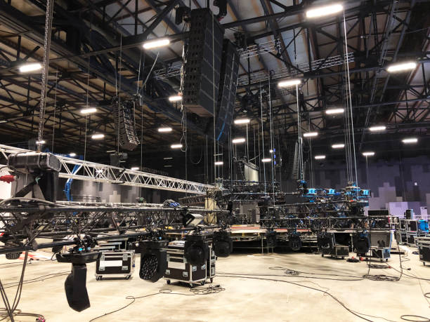 Installation of professional sound, light, video and stage equipment for a concert. Lifting of line array speakers. Installation of professional sound, light, video and stage equipment for a concert. Lifting of line array speakers. rigging stock pictures, royalty-free photos & images