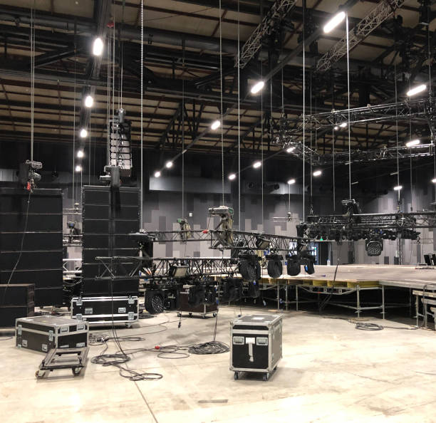 Installation of professional sound, light, video and stage equipment for a concert. Lifting truss and flight cases with cables. Installation of professional sound, light, video and stage equipment for a concert. Lifting truss and flight cases with cables. rigging stock pictures, royalty-free photos & images