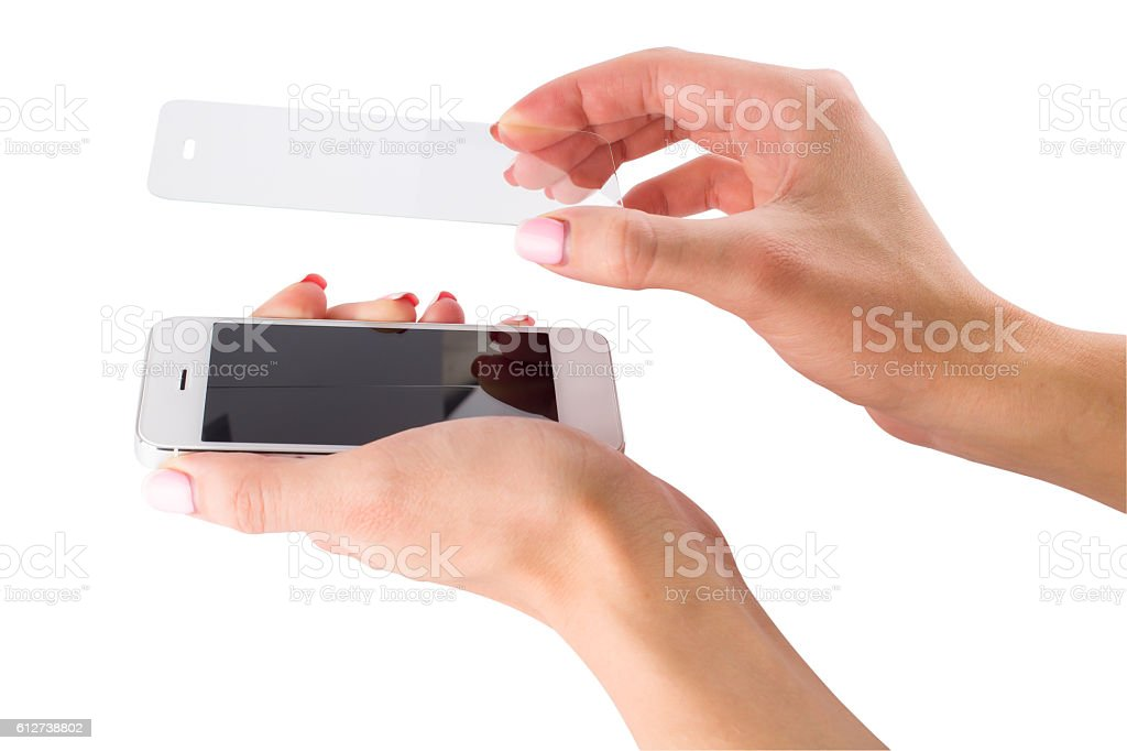 installation of protective glass on the smartphone stock photo