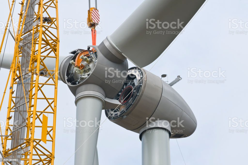 Installation the rotor blades on a wind turbine stock photo