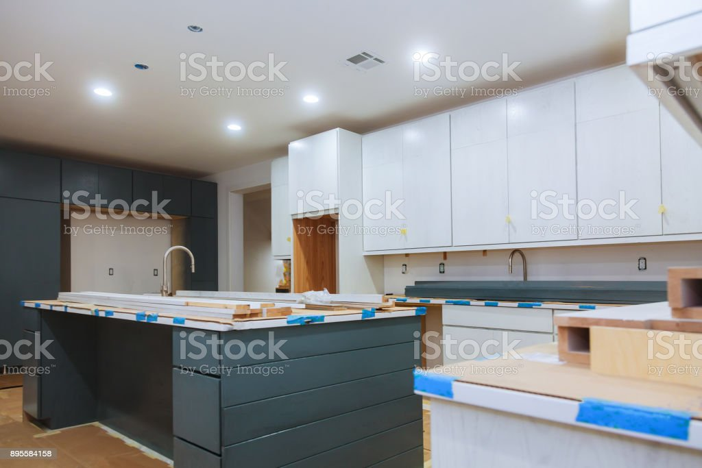 Installed kitchen in a new apartment in front. stock photo