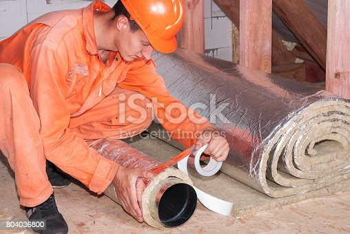1132163701istockphoto installer wraps the air duct 804036800