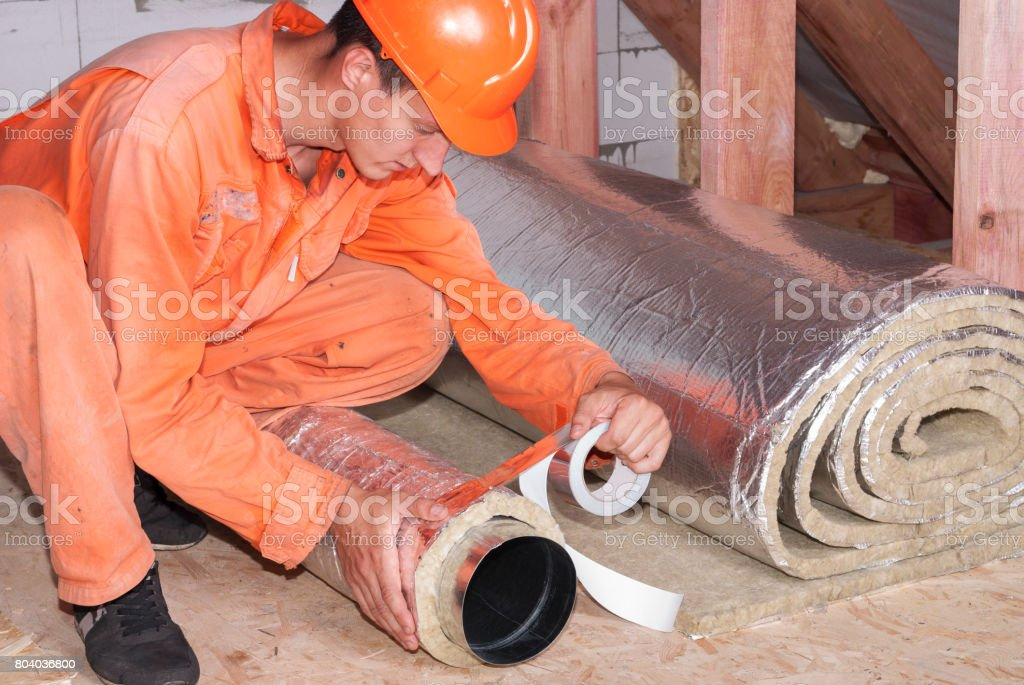 installer wraps the air duct stock photo