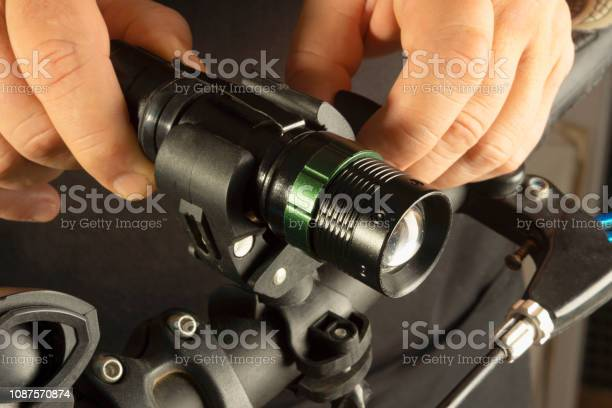 Installing A Bicycle Lantern In A Special Mount Stock Photo - Download Image Now