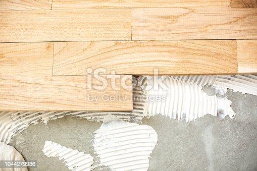 922081754istockphoto Installing a floor system  zoom in 1044279936