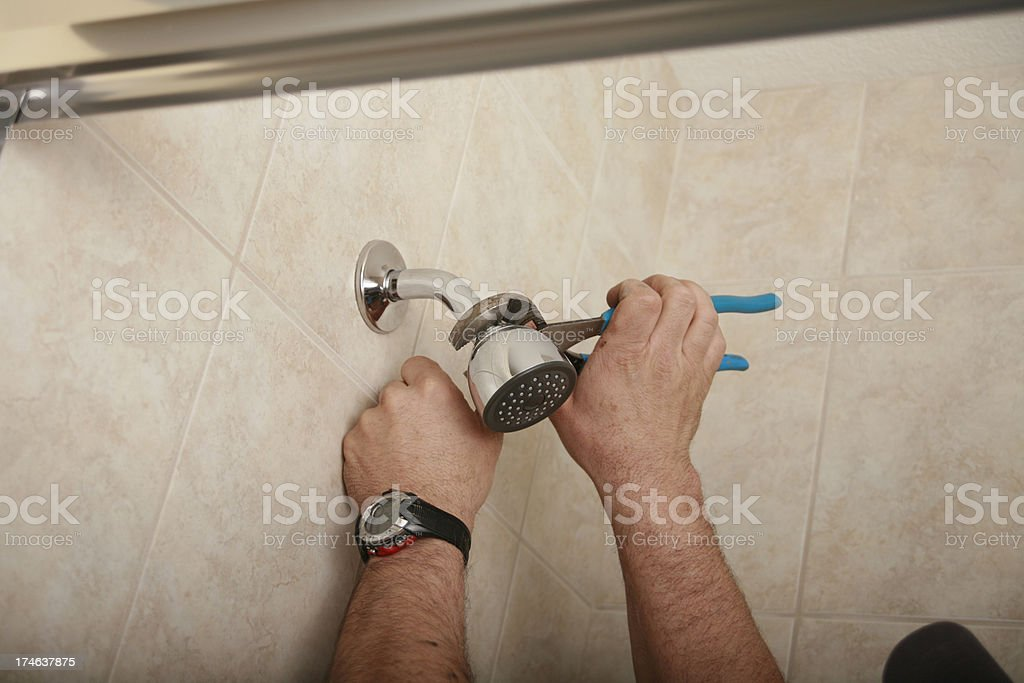 Installing A Shower Head royalty-free stock photo