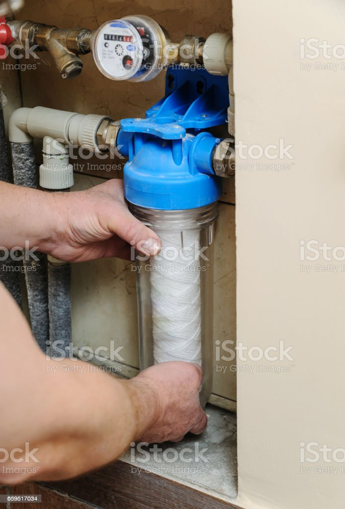 Installing a water filter in a plumbing. stock photo