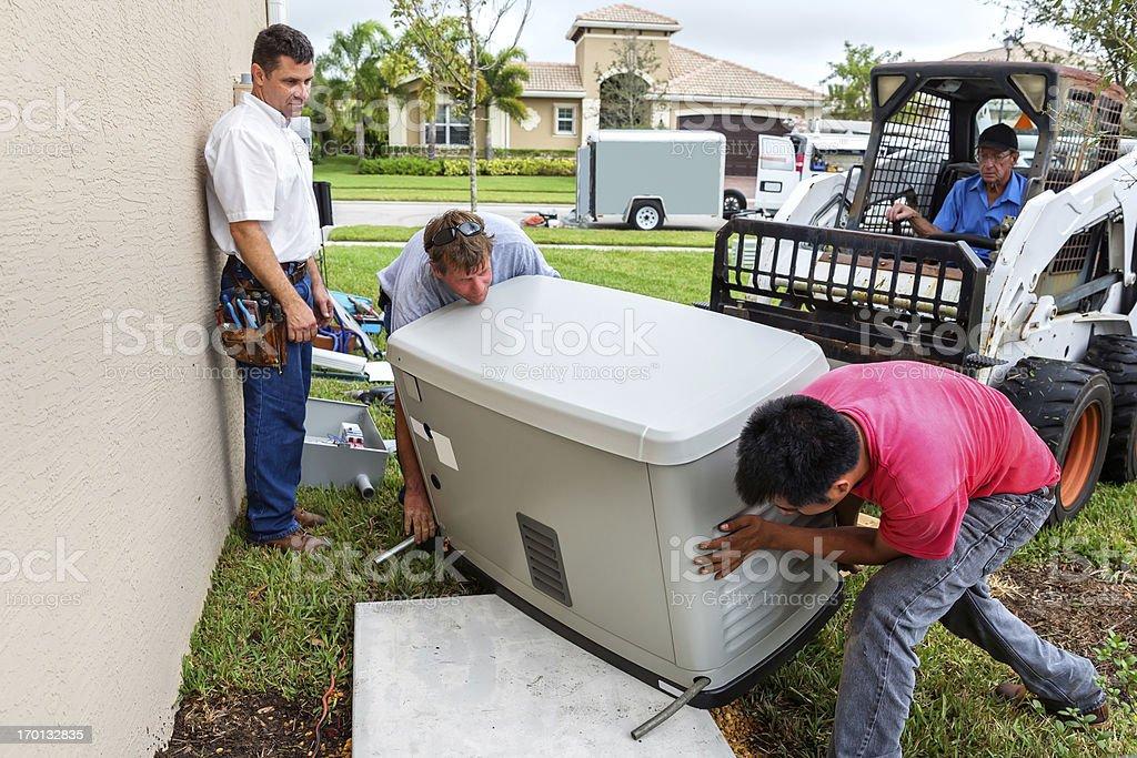 Installing an whole house emergency generator for hurricane season stock photo