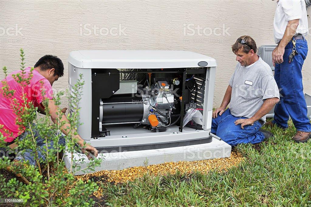 Installing an whole house emergency generator for hurricane season royalty-free stock photo