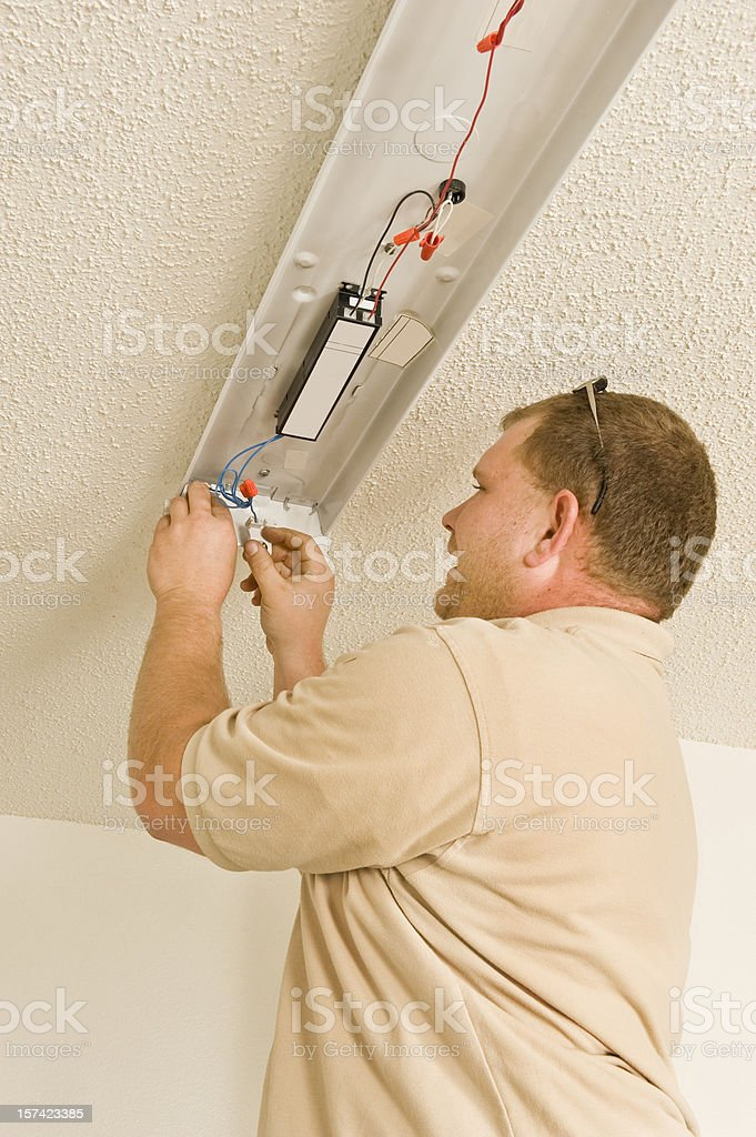 Installing Ballast In Electric Lighting Fixture royalty-free stock photo