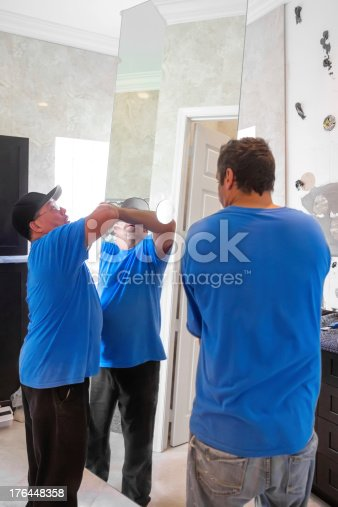istock Installing bathroom mirror 176448358