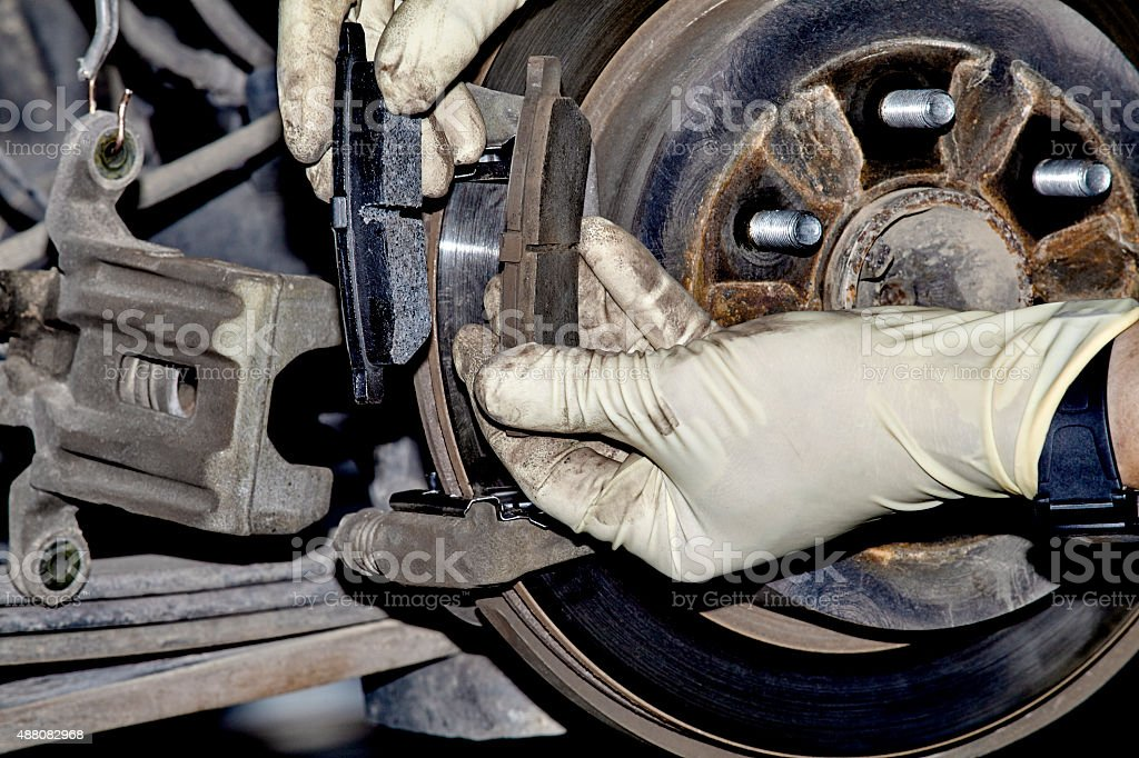 Installing Brake pads stock photo