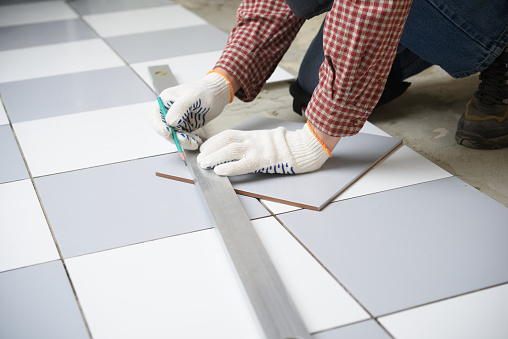 Installing Ceramic Tiles On A Floor Stock Photo - Download Image Now - iStock