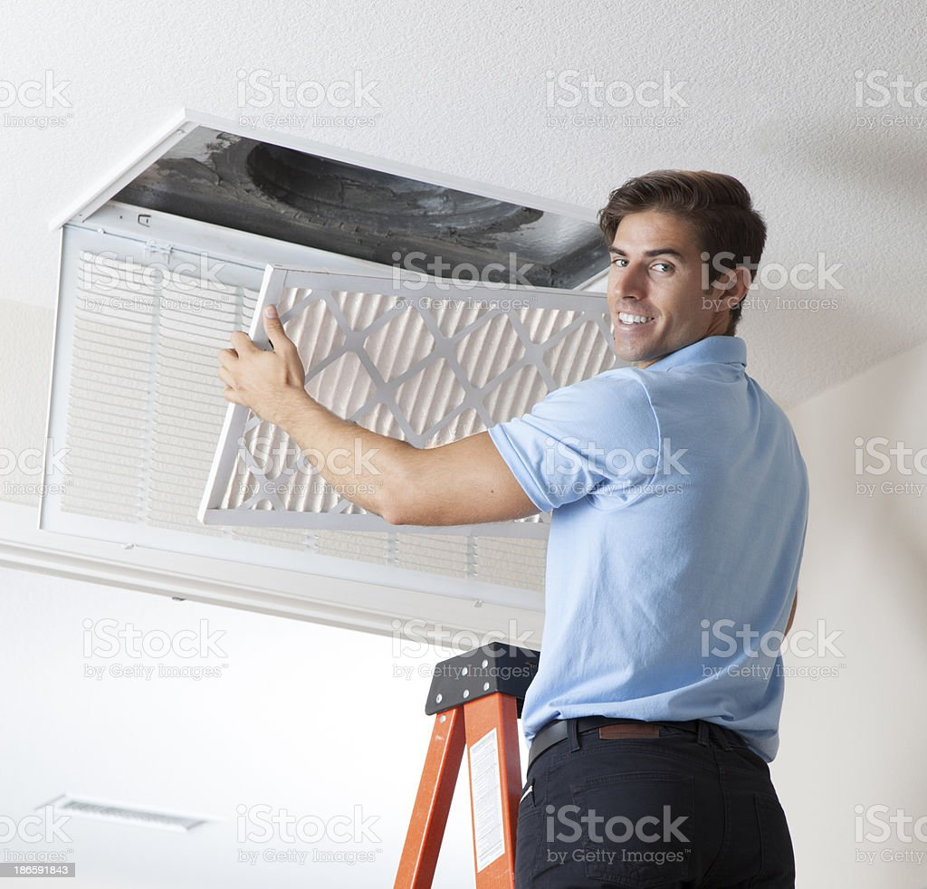 Installing Clean Air Filter stock photo