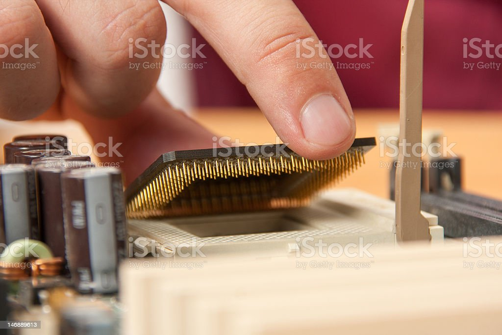 Installing computer processor royalty-free stock photo